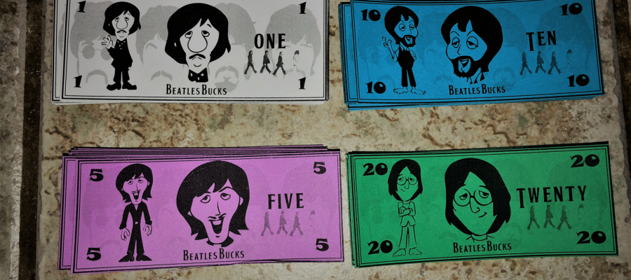 Beatle Bucks with John on the $20, Paul on the $10, George on the $5, and Ringo on the $1